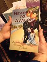 Hearken to Avalon Book Cover in hands 1