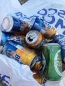 Beer cans bagged from the road