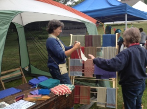 Irene Branson selling her homemade woven towels at the Ashfield Farmers Market